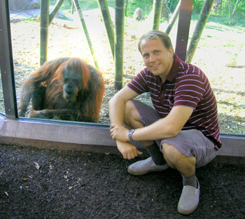 Anonymous reseacher at the San Diego Zoo shown here interacting with an Orangutan.